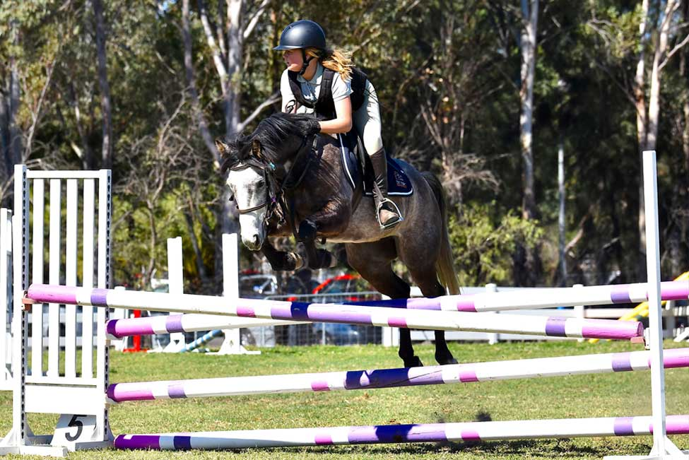 Olivia riding at a showjumping competition